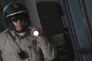 Patrolman with flashlight