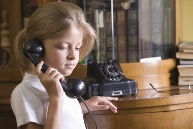 Girl using telephone