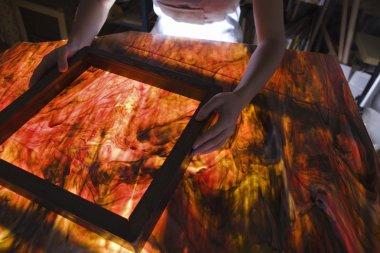 Artist producing textiles, close-up stock vector
