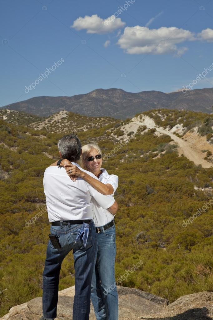 Senior couple hug with desert