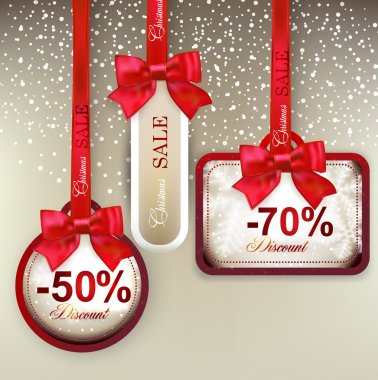 Sale labels with red gift bows