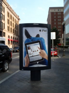 IPad Ad featuring Facebook use on an outdoor Ad stand