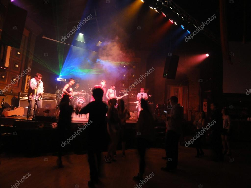 80's Cover band Strong Like Bull plays music on stage as crowd d