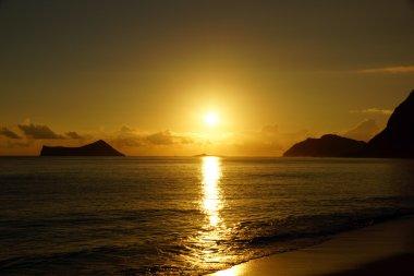 Early Morning Sunrise on Waimanalo Beach over Rock Island