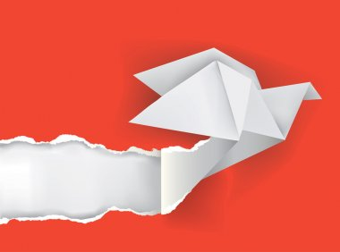 Origami bird ripping paper