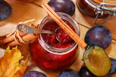 jar of homemade plum jam with cinnamon