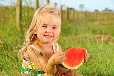 Smiling child with watermelon