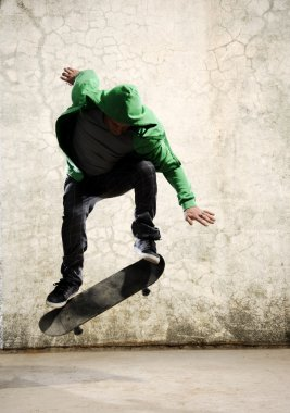 Skateboarder doing trick in mid air, grunge background stock vector
