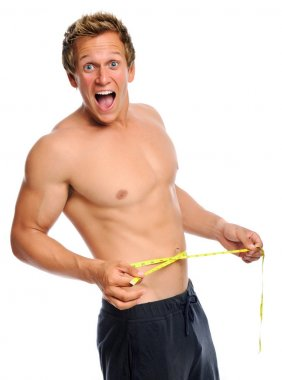 Excited man with measuring tape