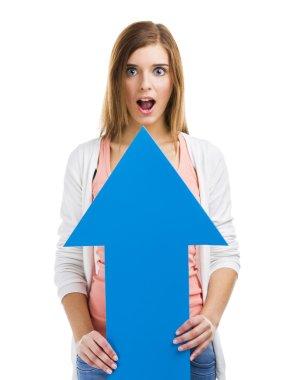 Woman holding a blue arrow