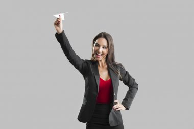 Woman throwing a paper plane