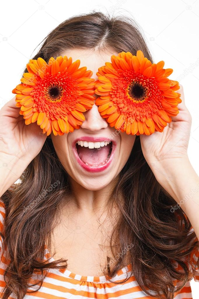 Woman covering her eyes with flowers \u2014 Stock Photo