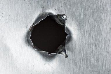 Bullet hole in sheet metal