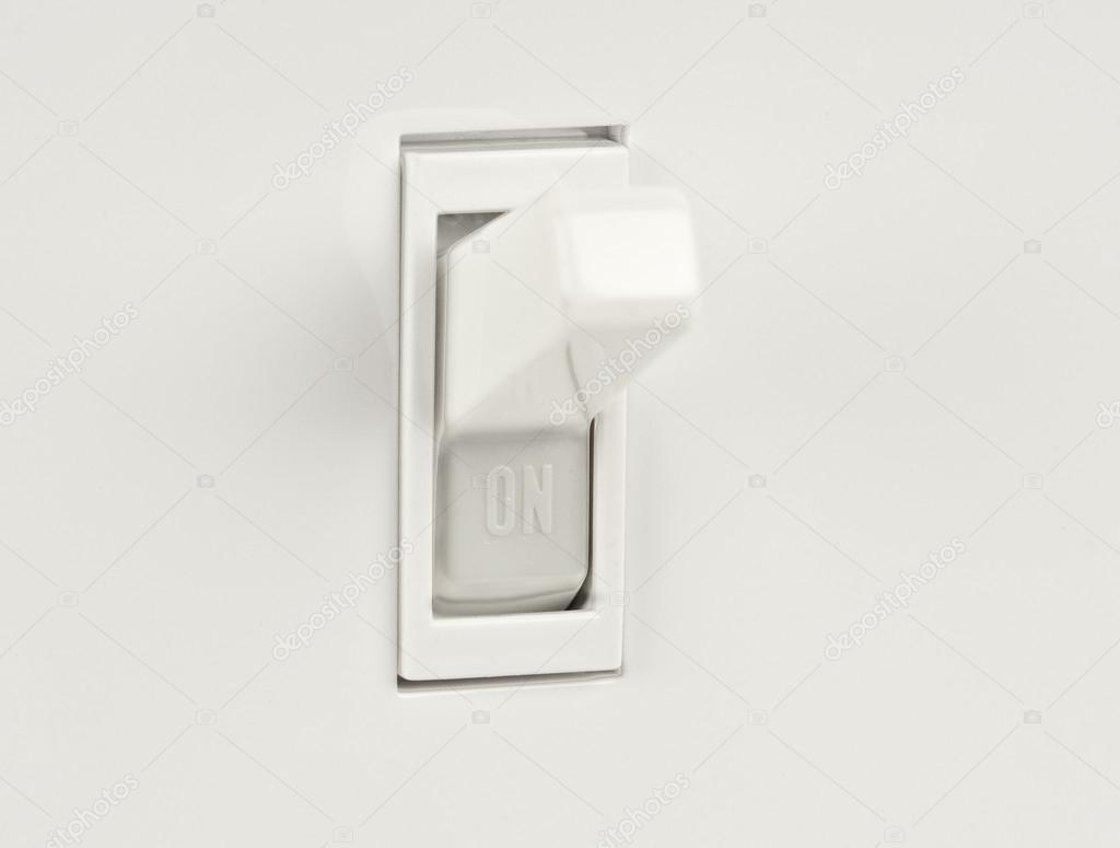 Traditional North American toggle electric light switch in ON ...