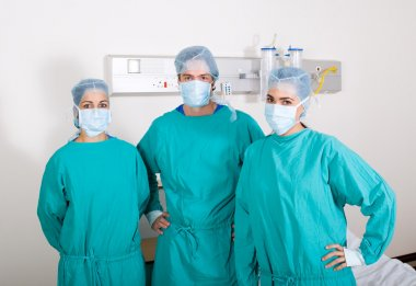 Group of surgeons in surgical gowns in hospital ward