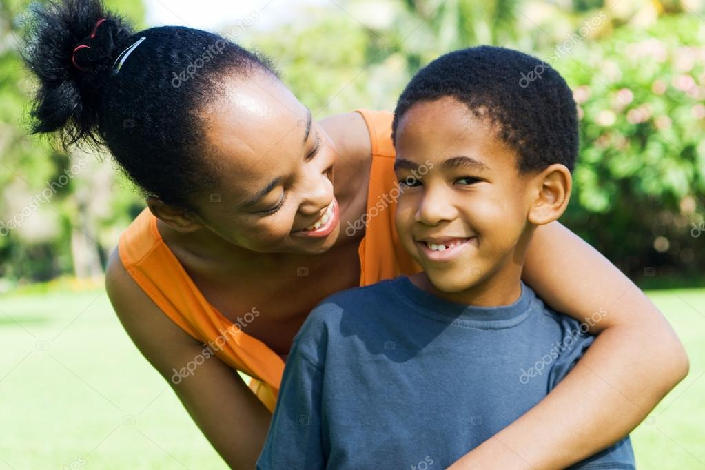Happy african american mother and son outdoors