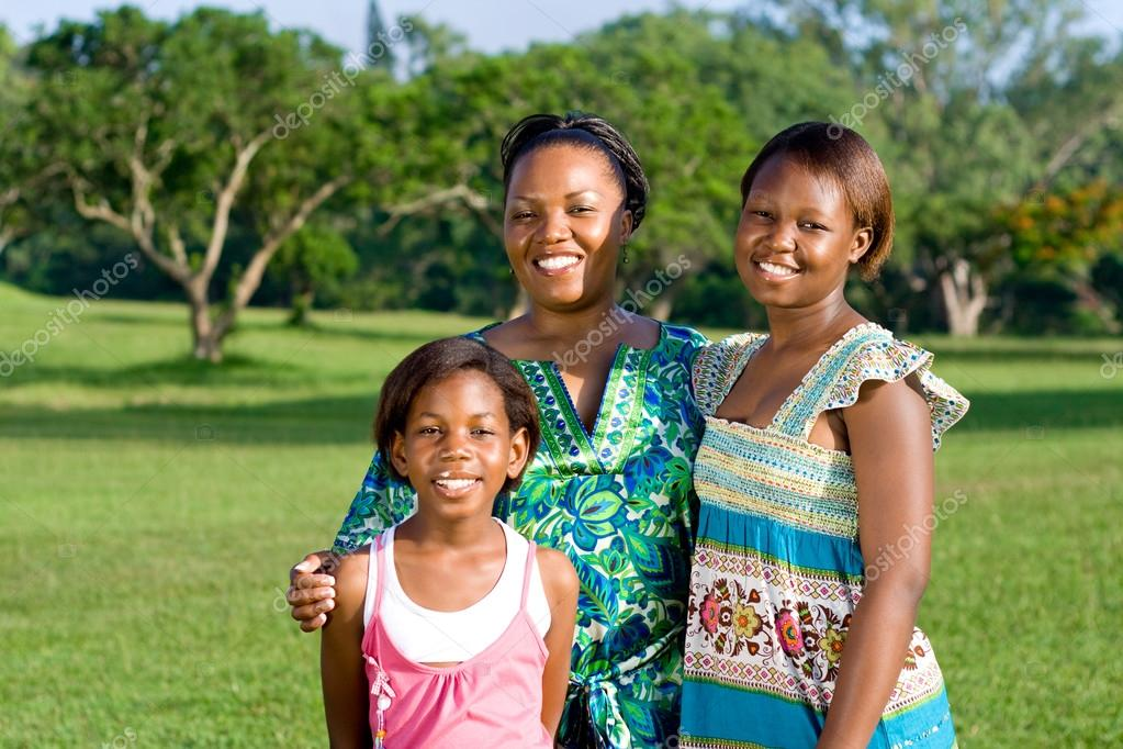 Happy african american mother and daughters portrait outdoors