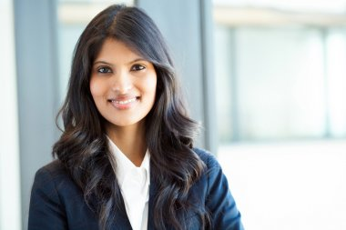 Young indian businesswoman portrait in office