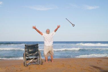 Senior man get up from wheelchair
