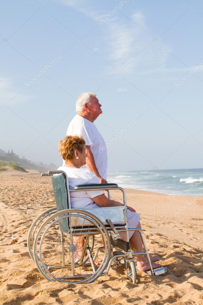 Senior man and disable wife