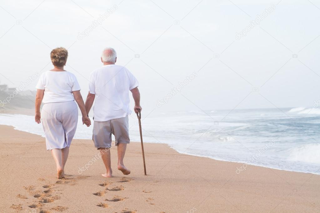 Senior couple hand in hand walking
