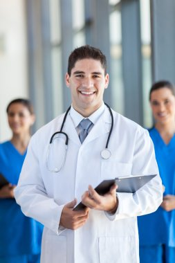 Team of young healthcare workers portrait in modern hospital