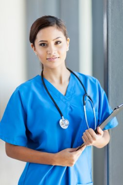 Beautiful medical nurse portrait in office