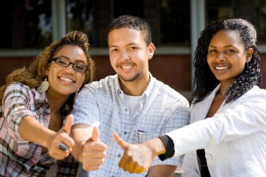 Group of african american college students thumbs up
