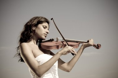 Peaceful violinist playing violin