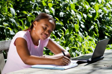 Female african college student studying outdoors