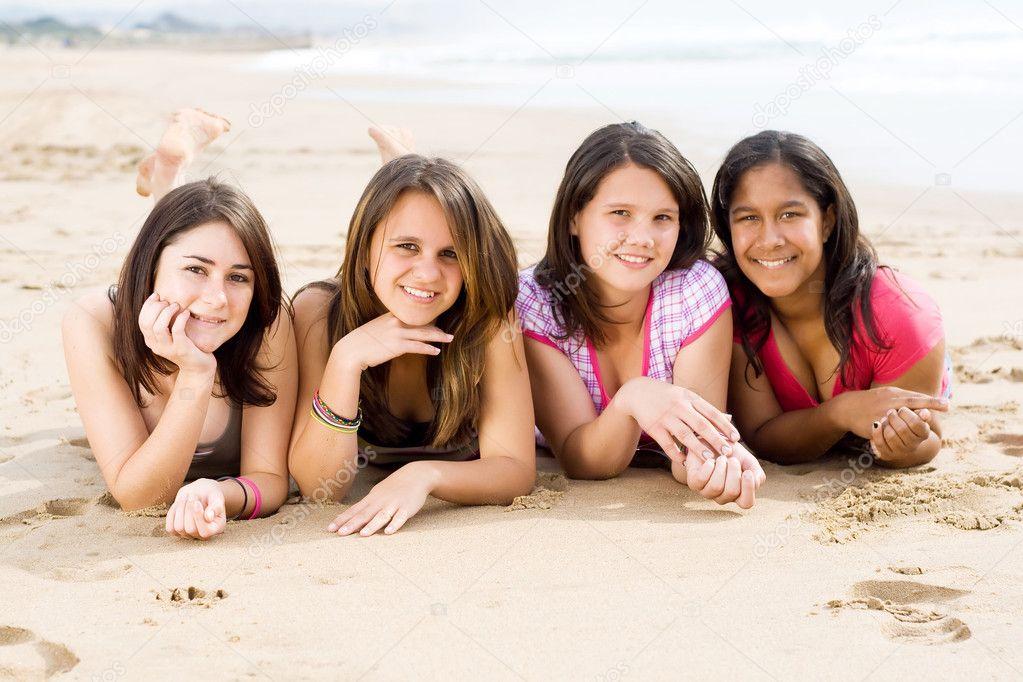 Group of teen girls lying on beach
