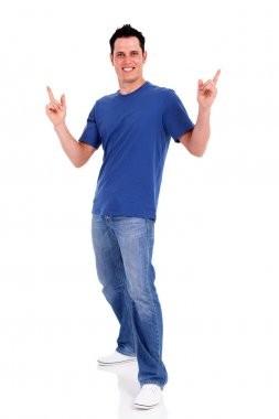 Casual young man pointing on white background