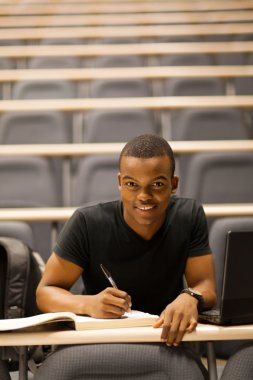 male african american college student in lecture hall