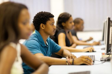 group of african university students in computer room