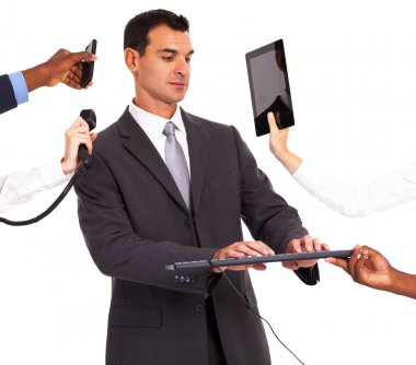 busy businessman working with multiple gadgets isolated on white