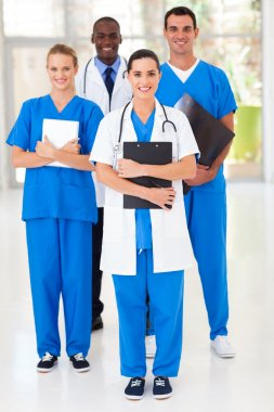 group of medical workers full length portrait in hospital