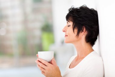 Woman enjoying a cup of coffee