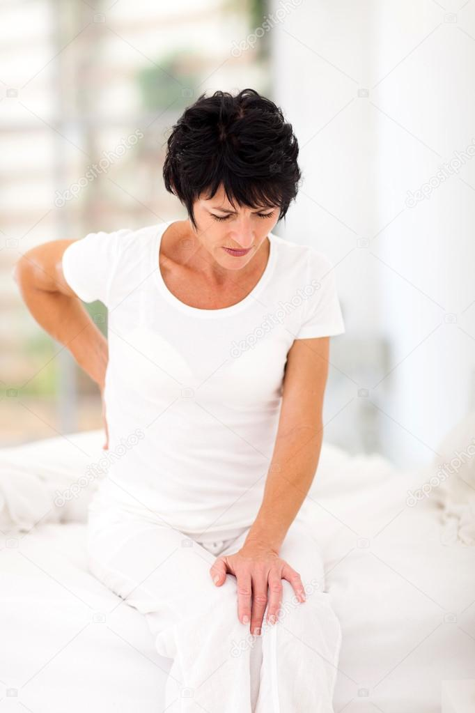 Болит спина на кровати