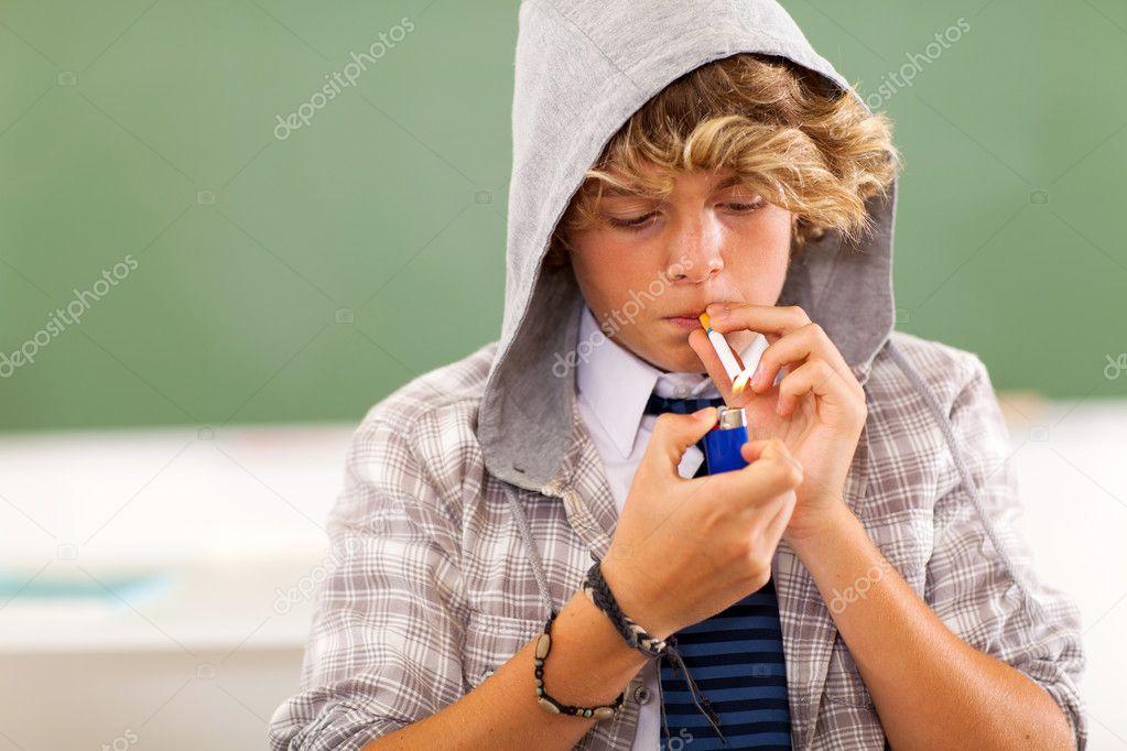 teen boy lighting cigarette