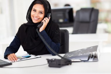 Arabian office worker on the phone