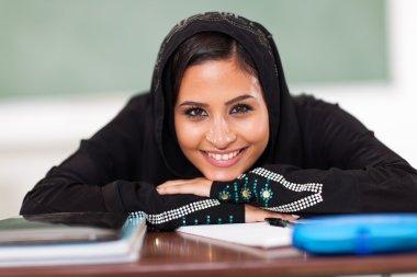 smiling Muslim female high school student