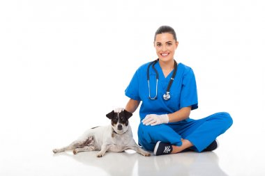 caring vet doctor sitting with pet dog