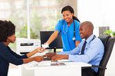 caring african nurse handover tissue