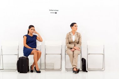 female candidates waiting for job interview