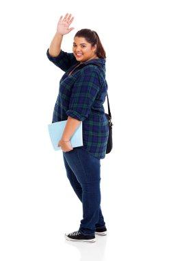 cheerful overweight student waving goodbye