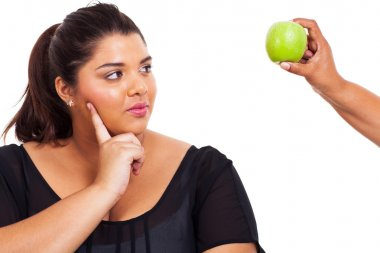 plus size woman thinking about going on diet