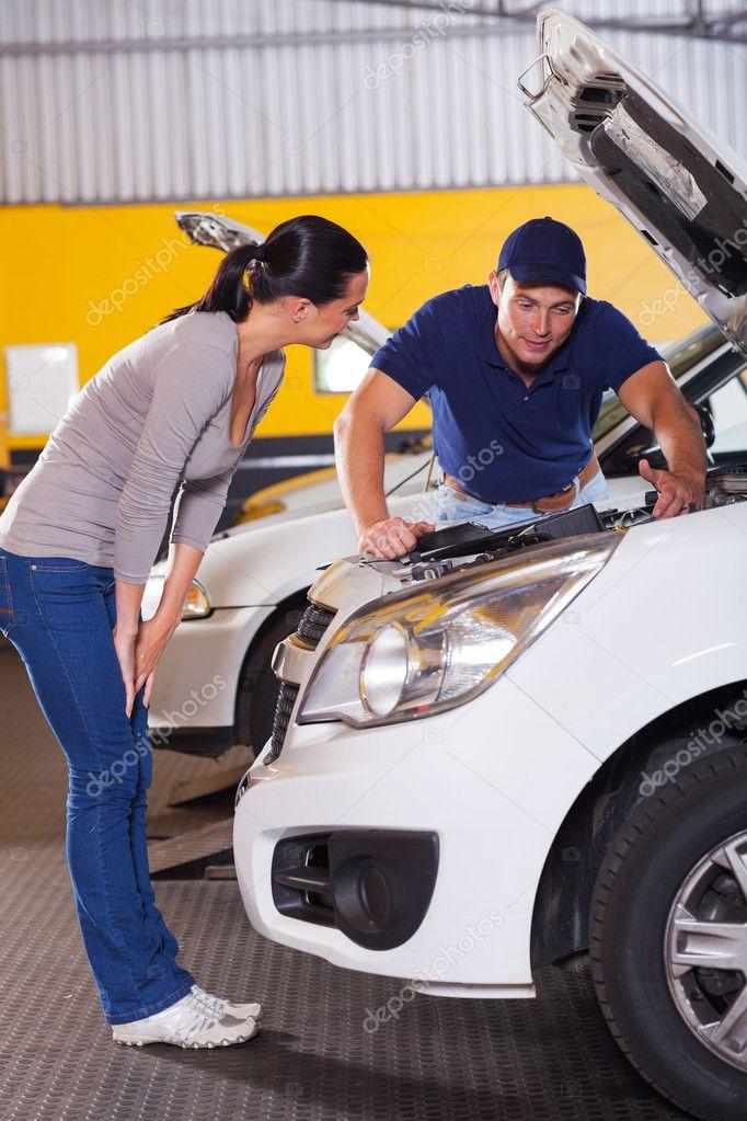 auto mechanic talking to customer