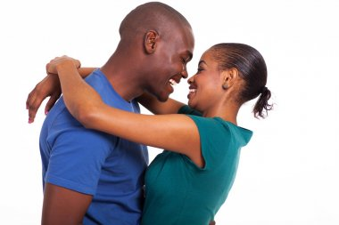 cheerful young african couple hugging
