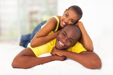 young black couple lying in bed