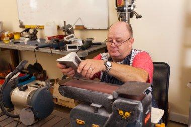 senior machinist working